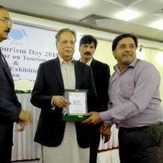 Ekrar receiving Lifetime achievement award in tourism from Federal minister for heritage and Managing director of PTDC